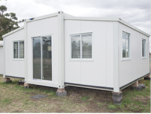 3-flat pack House Container 3 container pull out emergency shelter homes post disaster help Homes.Net